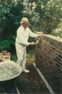 Pietro Laying Brick for a Garden Wall